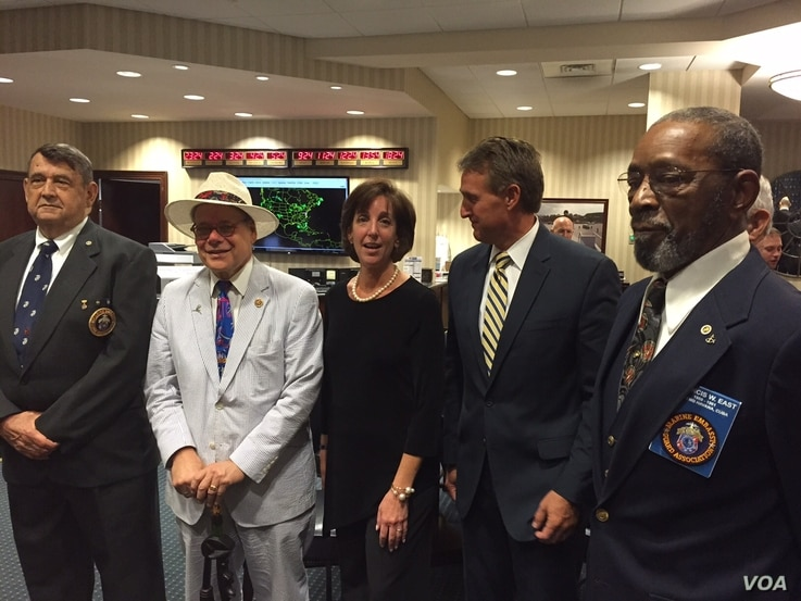 Far left and right: former Marines who were in Havana to lower flag 54 years ago and who will help raise it today.  Also pictured: Assistant Secretary of State for Western Hemisphere Affairs Roberta Jacobson, Tennessee Congressman Steve Cohen and Ari...