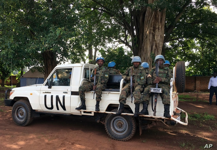 """United Nations Peacekeepers drive through  Yei, South Sudan, July 13, 2017. The United Nations peacekeeping mission's chief says Yei has """"gone through a nightmare."""" Since fighting spread to the city a year ago, 70 percent of the population has fled. ..."""