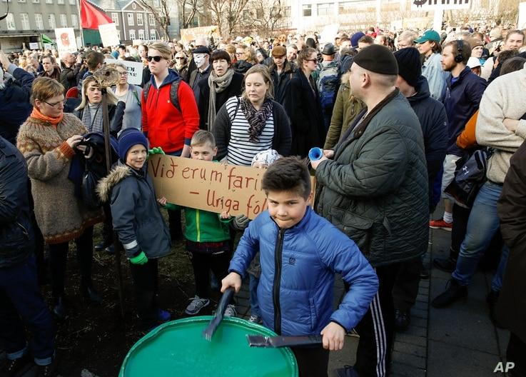People gather to demonstrate against Iceland's prime minister, in Reykjavik on April 4, 2016.