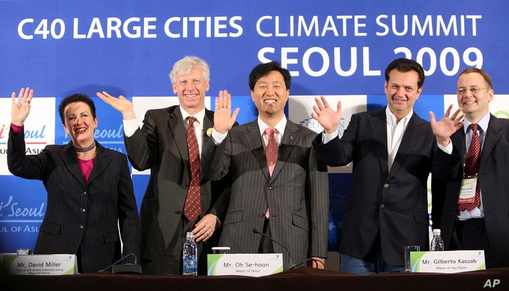 FILE - Mayors wave during a closing ceremony of the 3rd C40 Large Cities Climate Summit Seoul 2009 in Seoul, South Korea, May 21, 2009. Countries around the world should discuss giving more power and resources to city governments for the fight agains...