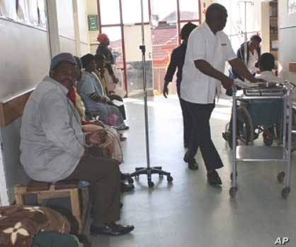People await attention from a general practitioner in a public hospital in South Africa, which is enduring serious shortages of doctors