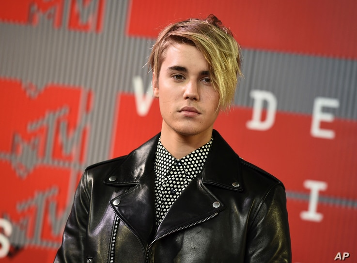 FILE - Justin Bieber arrives at the MTV Video Music Awards in Los Angeles.