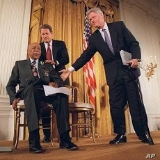 President Clinton and Vice President Al Gore, back, help Herman Shaw, 94, a Tuskegee Syphilis Study victim, during a news conference May 16, 1997, when Clinton apologized to black men whose syphilis went untreated by government doctors.