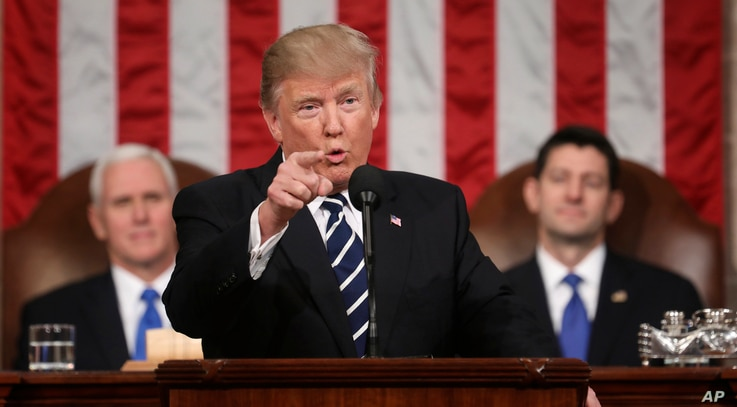 President Donald Trump addresses a joint session of Congress on Capitol Hill in Washington, Feb. 28, 2017. Vice President Mike Pence and House Speaker Paul Ryan of Wisconsin listen.