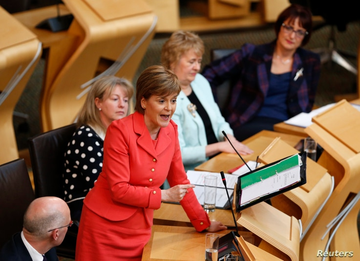 Scotland's First Minister, and leader of the Scottish National Party Nicola Sturgeon, speaks during First Minister's questions at the Scottish Parliament in Edinburgh, May 6, 2015.