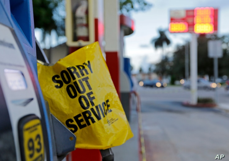 A gas pump is covered after a gas station ran out of gas, Sept. 7, 2017, in Miami.