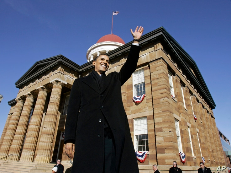 FILE - Then-U.S. Sen. Barack Obama, D-Ill., waves to spectators as he arrives to announce his candidacy for president of the United States at the Old State Capitol in Springfield, Ill., Feb. 10, 2007.