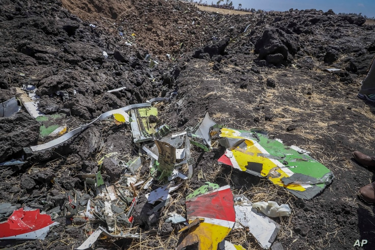 Wreckage lies at the scene of an Ethiopian Airlines flight that crashed shortly after takeoff at Hejere near Bishoftu, or Debre Zeit, some 50 kilometers (31 miles) south of Addis Ababa, in Ethiopia Sunday, March 10, 2019.