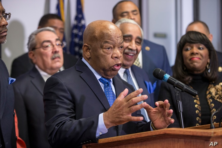 Rep. John Lewis, D-Ga., a leader of the civil rights movement, joins the Congressional Black Caucus Political Action Committee in endorsing Democratic presidential candidate Hillary Clinton during a news conference on Capitol Hill in Washington, Feb....