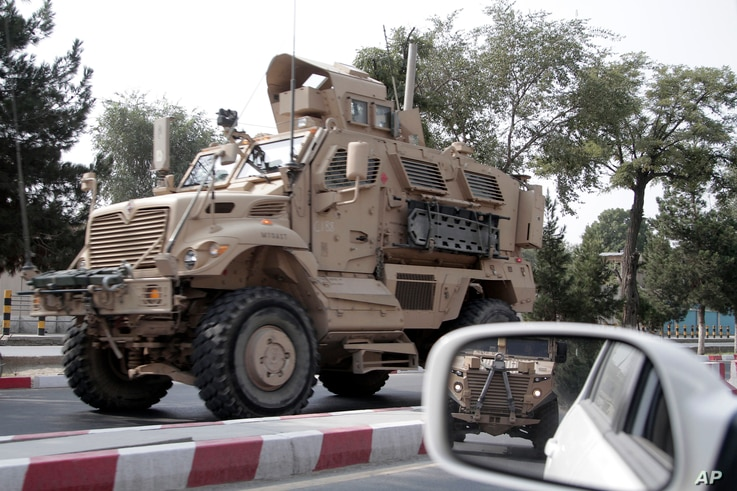 """A U.S. armored vehicle patrols in Kabul, Afghanistan, Aug. 23, 2017. In a national address Monday, U.S. President Donald Trump reversed his past calls for a speedy exit and recommitted the U.S. to the 16-year-old conflict, saying U.S. troops must """"fi..."""
