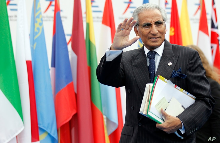 FILE - Pakistan's Special Assistant to Prime Minister on Foreign Affairs Syed Tariq Fatemi arrives for the 10th Asia-Europe Meeting (ASEM) in Milan, Italy, Oct. 16, 2014.