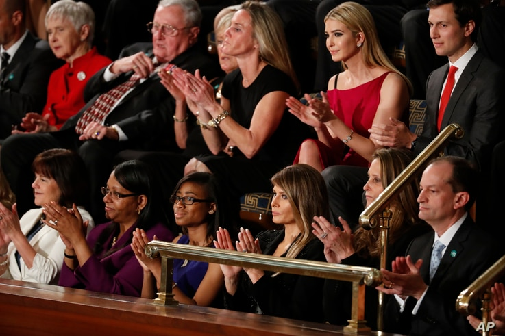First Lady Melania Trump, and guests, applaud on Capitol Hill in Washington, Feb. 28, 2017, during President Donald Trump's address to a joint session of Congress.