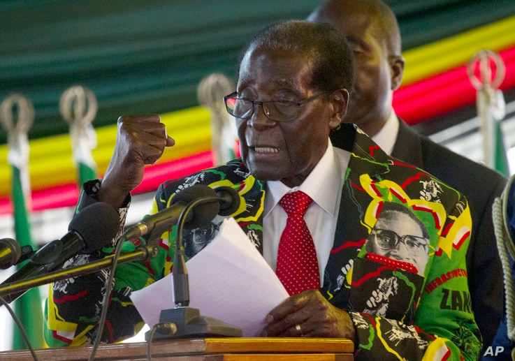 Zimbabwe President Robert Mugabe delivers his speech at the opening session of his party's 16th Annual Peoples Conference in Masvingo, about 300 kilometres, south of the capital Harare, Friday Dec. 16, 2016.