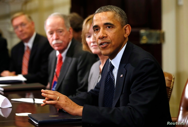 U.S. President Barack Obama meets with health insurance chief executives at the White House in Washington Nov. 15, 2013.