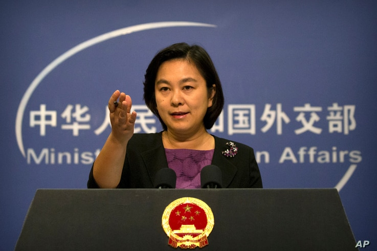 FILE - Chinese foreign ministry spokeswoman Hua Chunying gestures during a press briefing at the Ministry of Foreign Affairs building in Beijing.