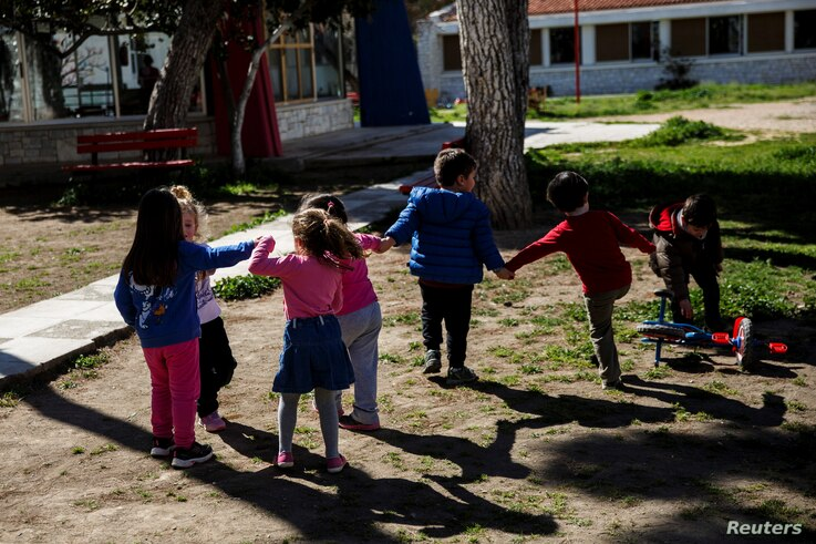 Children play in the yard of the Model National Nursery of Kallithea, in Athens, Greece, March 3, 2017.
