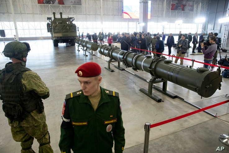 Russian military officers stand by as the 9M729, center, its launcher, left, and the 9M728, right, land-based cruise missiles are displayed in Kubinka outside Moscow, Russia, Jan. 23, 2019. The Russian military on Wednesday rolled out its new missile...