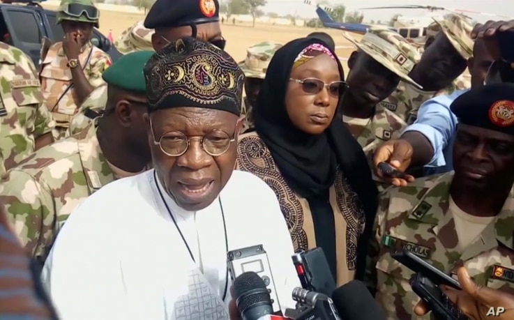 In this image taken from video, Lai Muhammed, Nigerian Minister of Information, speaks to the media in Dapchi, Yobe State, Nigeria, Feb. 22, 2018.
