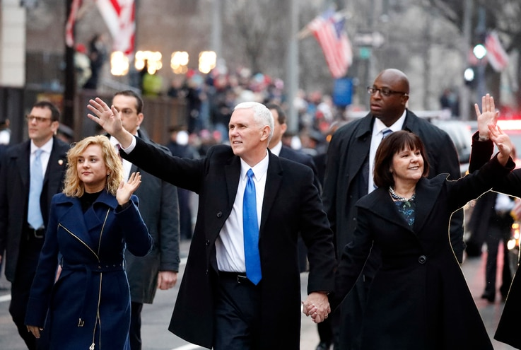 Vice President Mike Pence walks in the inauguration parade with his wife, Karen, and daughter Charlotte, left, in Washington, Jan. 20, 2017.