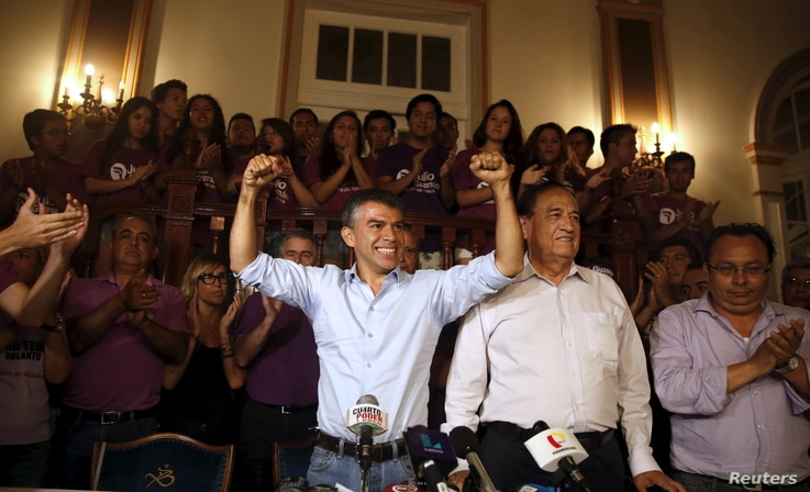"""Peru's presidential candidate Julio Guzman gestures at a news conference after the Special Jury of Elections accepted a citizen's petition to declare Guzman's candidacy """"inadmissible"""" for the upcoming April elections, Lima, March 4, 2016."""