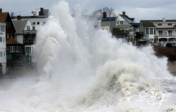 A large wave crashes into a seawall in Winthrop, Massachusetts, March 3, 2018, a day after a nor'easter pounded the Atlantic coast.