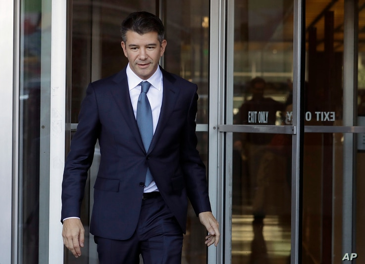 FILE- Ousted Uber CEO Travis Kalanick leaves federal court in San Francisco on Feb. 7, 2018. Uber has settled a lawsuit alleging that it ripped off self-driving car technology from Google's autonomous vehicle division.