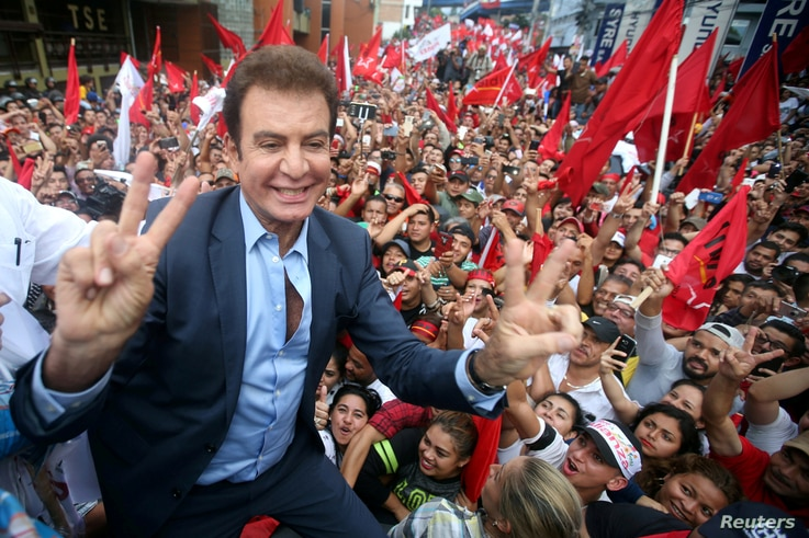 Salvador Nasralla, presidential candidate for the Opposition Alliance Against the Dictatorship, celebrates with supporters while waiting for official presidential election results outside the Supreme Electoral Tribunal in Tegucigalpa, Honduras, Nov. ...