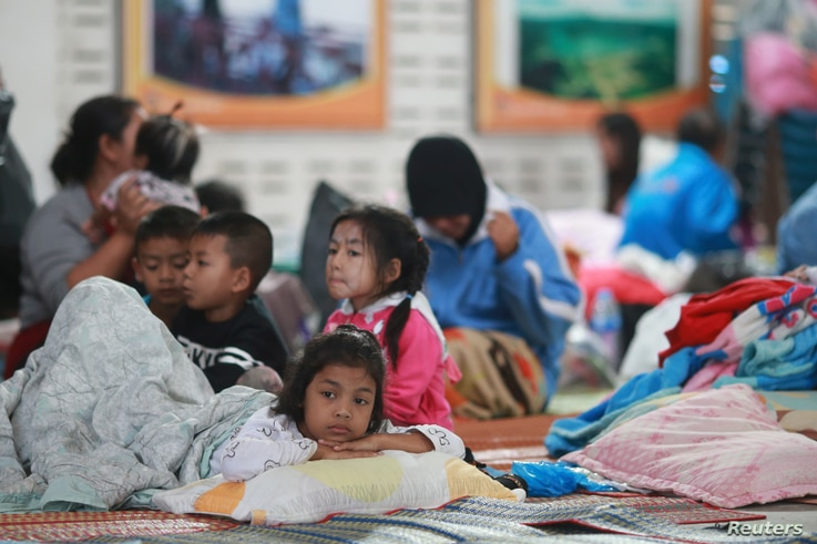 Children who were evacuated from their homes are seen at a evacuation center as tropical storm Pabuk approaches the southern province of Nakhon Si Thammarat, Thailand, Jan. 4, 2019.