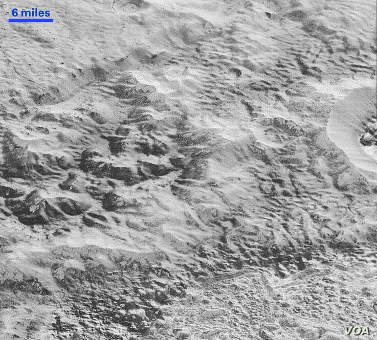 This highest-resolution image from NASA's New Horizons spacecraft shows how erosion and faulting have sculpted this portion of Pluto's icy crust into rugged badlands topography, Dec. 4, 2015.