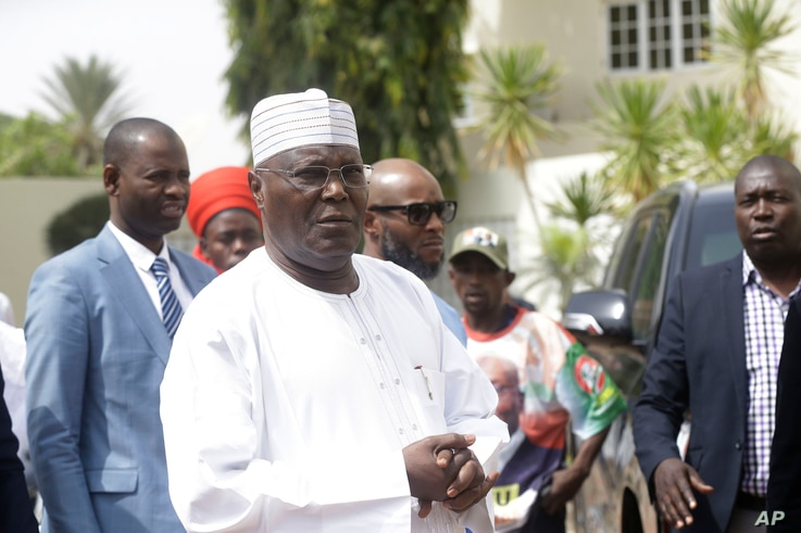 FILE - Nigerian presidential candidate Atiku Abubakar of the People's Democratic Party, speaks to journalists at his residence in Yola, Nigeria, Feb. 16, 2019.