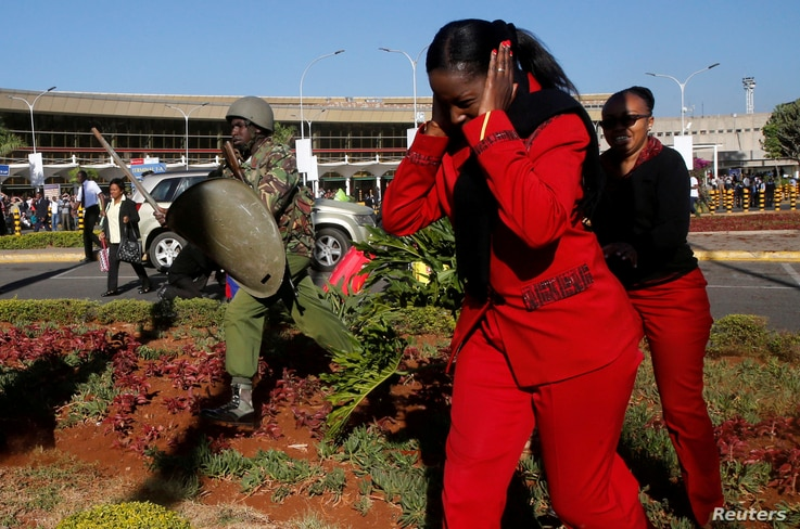 Kenya Airways workers are dispersed by riot police officers at the Jomo Kenyatta International Airport during a labor dispute that grounded flights near Nairobi, Kenya, March 6, 2019.