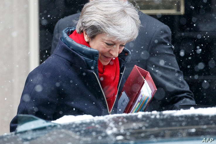 British Prime Minister Theresa May leaves 10 Downing street for the weekly Prime Minister Question (PMQ) session in the House of Commons in London, Feb. 28, 2018.