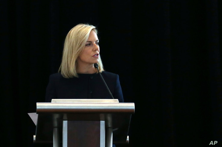 U.S. Department of Homeland Security Secretary Kirstjen Nielsen addresses a convention of state secretaries of state, July 14, 2018, in Philadelphia. Nielsen told the gathering that there are no signs that Russia is targeting this year's midterm elec...