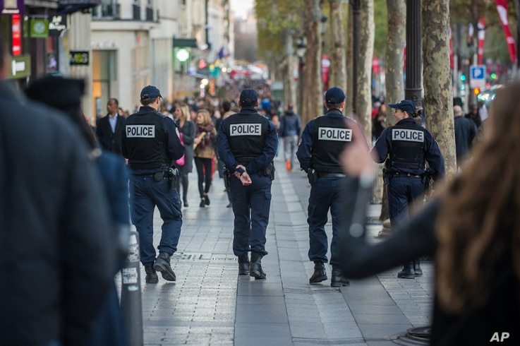 French police officers patrol on the Champs Elysees in Paris, Nov. 15, 2015. Thousands of French troops deployed around Paris on Sunday and at tourist sites.