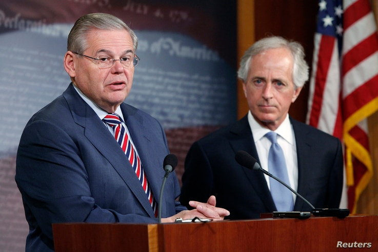 U.S. Senate Foreign Relations Committee Chairman Robert Menendez (L) and ranking member Senator Bob Corker (R) hold a news conference after a Senate vote on an aid package for Ukraine at the U.S. Capitol in Washington March 27, 2014.