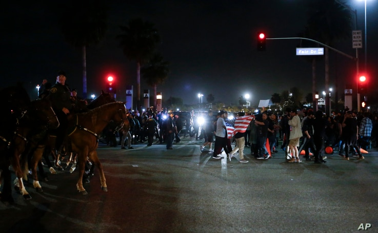 Protesters crowd the street after a rally for Republican presidential candidate Donald Trump, Thursday, April 28, 2016.