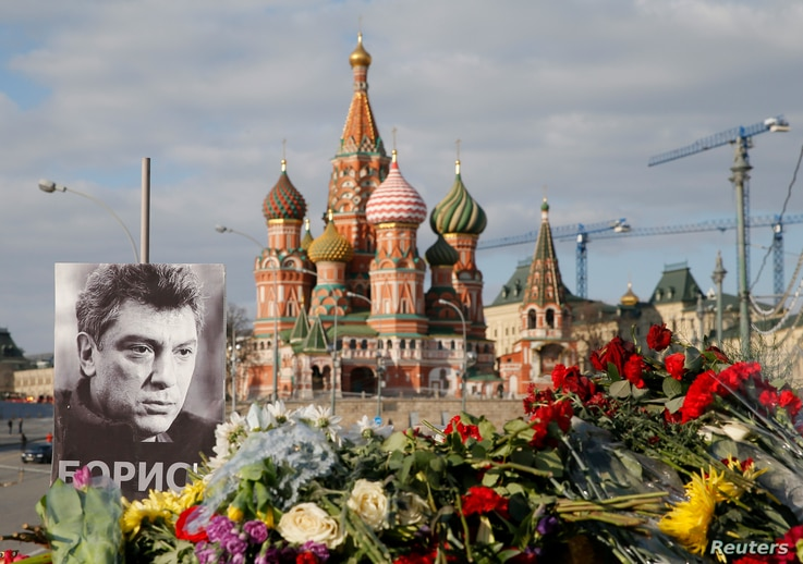 A portrait of Kremlin critic Boris Nemtsov and flowers are pictured at the site where he was killed on February 27, with St. Basil's Cathedral seen in the background, at the Great Moskvoretsky Bridge in central Moscow, March 6, 2015.