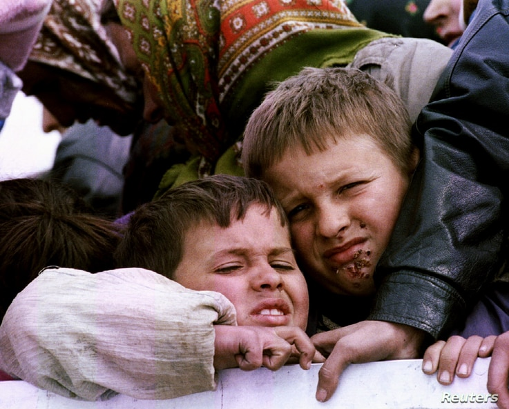 FILE - Bosniak refugees being evacuated from besieged Srebrenica in 1993 as part of a negotiated agreement.