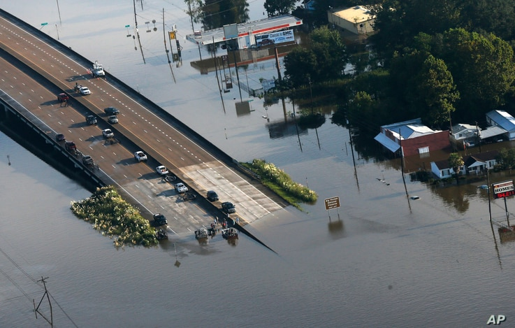 People launch boats from an overpass into floodwaters in the aftermath of Tropical Storm Harvey in Kountze, Texas, Aug. 31, 2017.