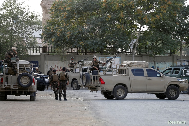 Afghan security forces arrive at the site of a blast in Kabul, Afghanistan, July 15, 2018.