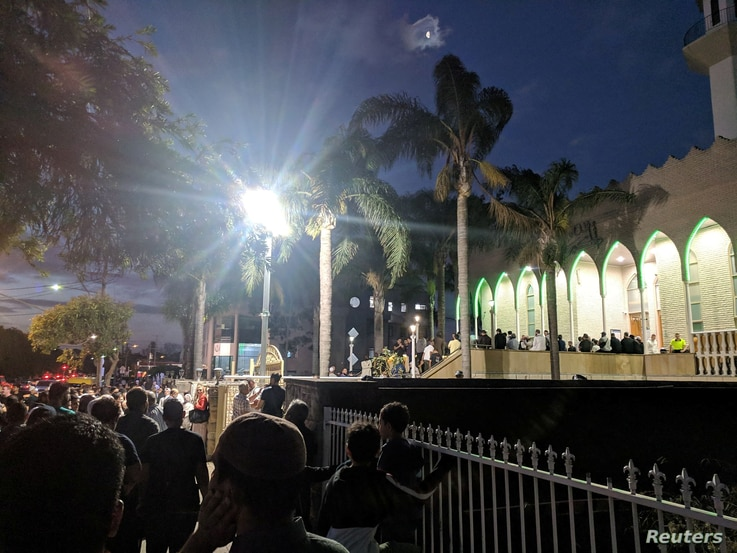 People gather at a vigil for Christchurch shootings victims at Lakemba Mosque in Sydney, Australia, March 15, 2019 in this picture obtained from social media.