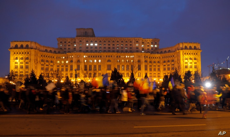 Demonstrators march in front of the government building during a protest in Bucharest, Romania, Feb. 4, 2017. On Saturday, thousands of Romanians took to the streets for a fifth consecutive day to protest a decree that waters down the country's anti-...