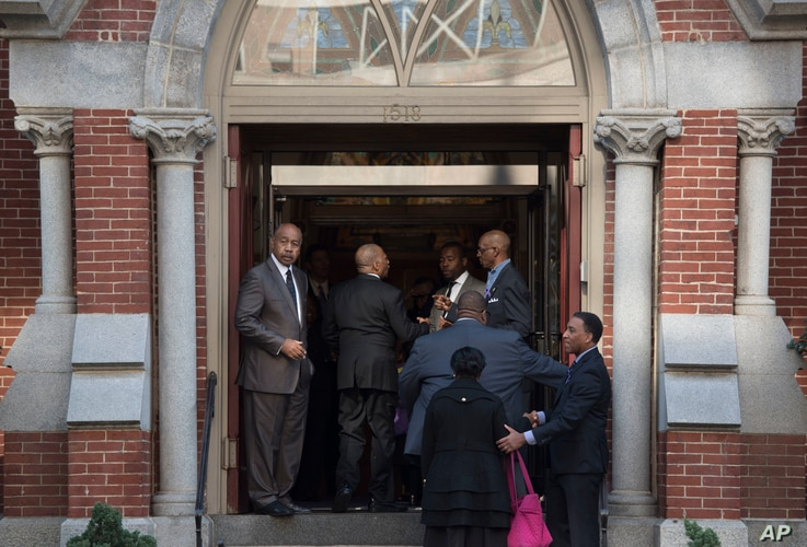 Attendees arrive at Metropolitan A.M.E. Church for the memorial service for journalist Gwen Ifill in Washington, Nov. 19, 2016.
