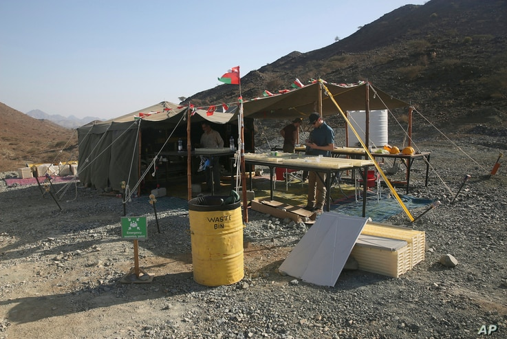 The research tent of the Oman Drilling Project is pictured in the al-Hajjar mountains of Oman, March 1, 2017. Geologists are searching for an efficient and cheap way to remove carbon dioxide from the air and oceans.