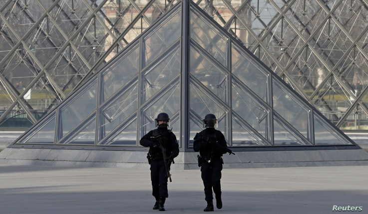 man armed with a machete and carrying two bags on his back as he tried to enter the Paris Louvre museum.