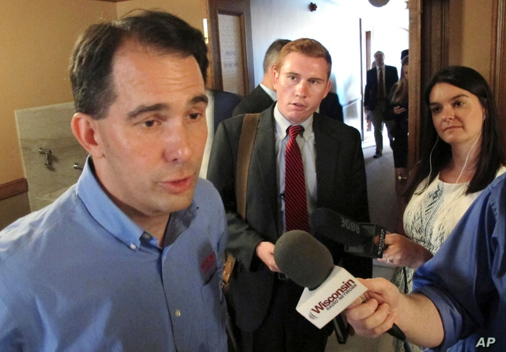 Wisconsin Gov. Scott Walker speaks to the media Tuesday, Aug. 1, 2017, in Madison, Wis.