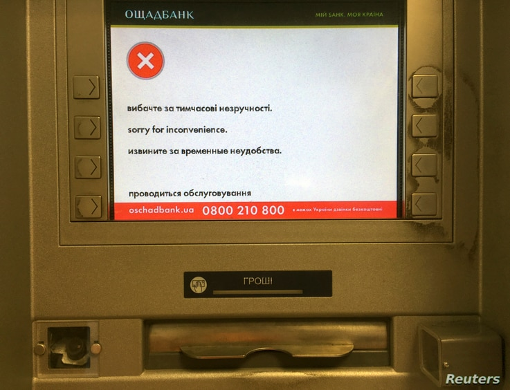"""A screen of an idle virus affected cash machine in a state-run OshchadBank says """"Sorry for inconvenience/Under repair"""" in Kiev, Ukraine, June 28, 2017."""