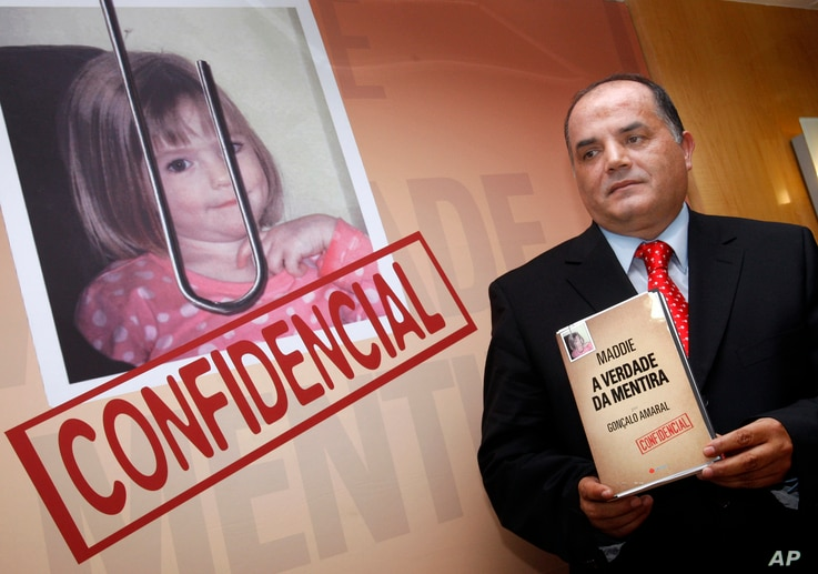 """FILE- Former detective Goncalo Amaral poses with his book, July 24, 2008, whose title translates as """"The Truth in the Lies,"""" during its launch in Lisbon. Amaral says in the book he is convinced that Madeleine McCann died in the vacation apartment fro..."""