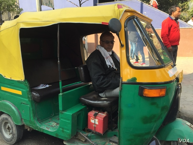 Auto rickshaw driver Ashok Lohia says he has no option but to continue plying his auto rickshaw in Delhi although the toxic air gives him headaches and eye problems in winter when pollution peaks.