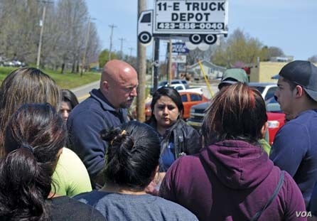 A Department of Homeland Security official speaks with the families of detainees outside the National Guard Armory. April 5, 2018, in Hamblen County, Tennessee. (Photo courtesy Morristown Citizen Tribune)